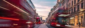 Blurred image of buses moving quickly