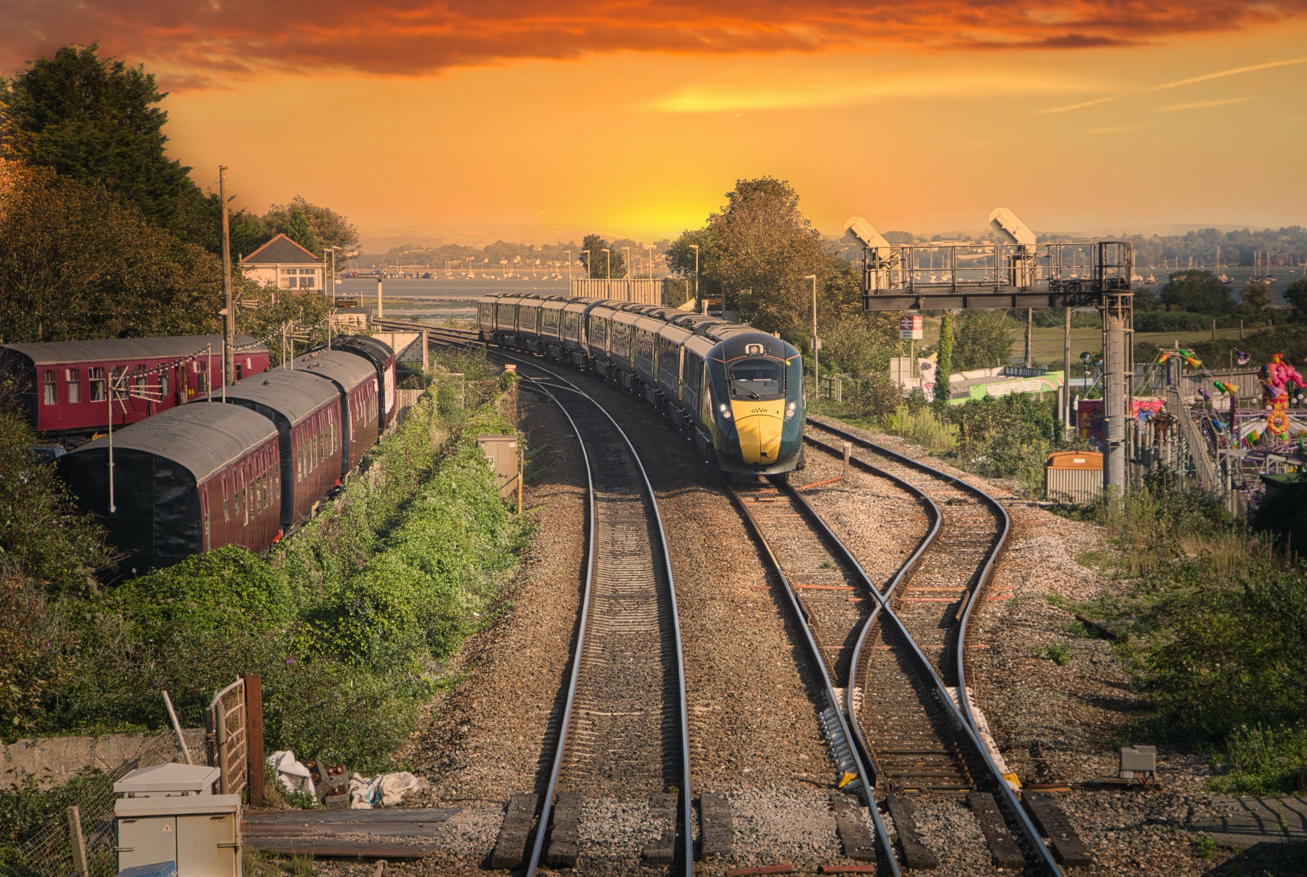 Picture of train travelling along tracks at sunset