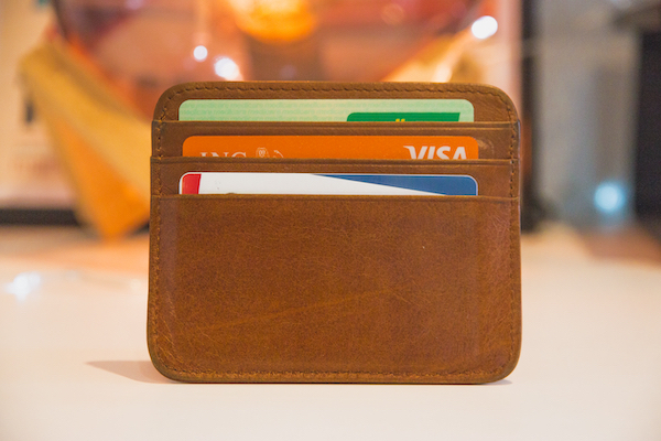 A wallet with credit cards in it